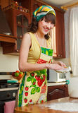 The girl on kitchen Stock Images