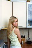 The girl on kitchen Royalty Free Stock Photos