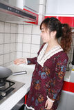 Girl in kitchen. Young asia girl at kitchen Royalty Free Stock Photography