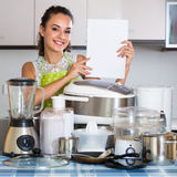 Girl with kitchen appliances at home Royalty Free Stock Photos