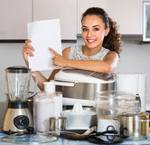 Girl with kitchen appliances at home Stock Images