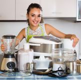 Girl with kitchen appliances at home Royalty Free Stock Photography