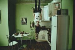 Girl in kitchen ceiling Royalty Free Stock Photos