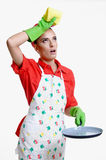 Girl and kitchen concept. Beautiful young girl in the kitchen cleaning and cooking concept, isolated on white stock images