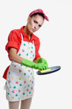 Girl and kitchen concept. Beautiful young girl in the kitchen cleaning and cooking concept, isolated on white royalty free stock photography
