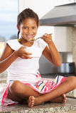 Girl In Kitchen Eating Bowl Of Breakfast Cereal Royalty Free Stock Photos
