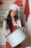 Girl in the kitchen stock photos