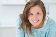 Girl in the kitchen smiles. Beautiful girl in the kitchen smiles stock photo