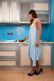 Girl in the kitchen takes fruit. Girl in the kitchen takes the fruit from plate Royalty Free Stock Photo