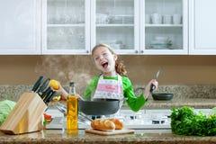 Girl on kitchen Stock Photo