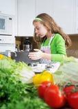 Girl on kitchen Royalty Free Stock Image