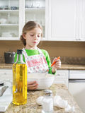 Girl on kitchen Stock Image