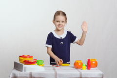 Girl in the kitchen waving goodbye Royalty Free Stock Images