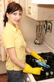 The girl on kitchen wipes an oven Royalty Free Stock Images