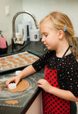 Girl in kitchen Royalty Free Stock Images