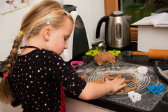 Girl in kitchen Royalty Free Stock Image