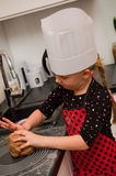 Girl in kitchen Royalty Free Stock Photo