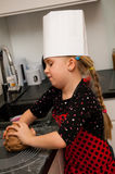 Girl in kitchen Royalty Free Stock Photos