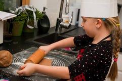 Girl in kitchen Stock Image