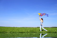 Girl and kite Stock Images