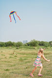 The girl with a kite Stock Images