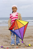 Girl (5-7) with kite on beach, portrait Royalty Free Stock Photos