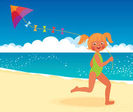 Girl with a kite on the beach running Royalty Free Stock Photo