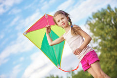 Girl with a kite Royalty Free Stock Photo