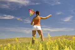Girl kite fly. Beautiful young girl kite fly Royalty Free Stock Photo
