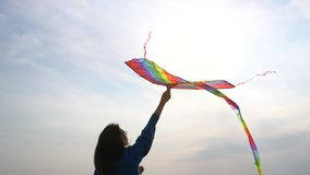 Girl with a kite in her hand stock video