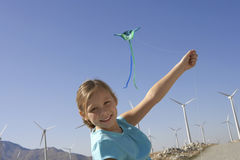 Girl With A Kite At Windmill Farm Royalty Free Stock Images
