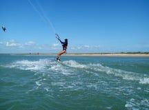 Girl kitesurfing royalty free stock image