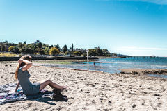 Girl at Kitsilano Beach in Vancouver, Canada Stock Images
