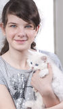 Girl with kitten. Blue-eyed girl with blue-eyed kitten Royalty Free Stock Image