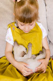 Girl with a kitten Royalty Free Stock Photo