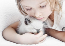 Girl and  kitten. Little cute girl affectionately hugging  kitten Stock Photos