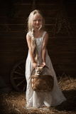 Girl with a kitten in a basket Royalty Free Stock Photo