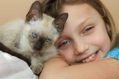 Girl with kitten Stock Photos