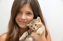 Girl with kitten stock photography