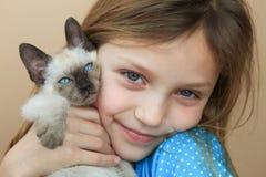 Girl with kitten Stock Image