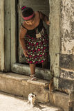 Girl and kittens Havana. Girl in doorway an two kittens in Old Havana (Spanish: Habana Viejo), Cuba. Citizens of Havana is called Habaneros in Spanish Royalty Free Stock Photos