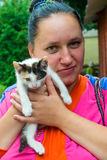 Girl with kittens. The girl is holding small colored kitten royalty free stock images