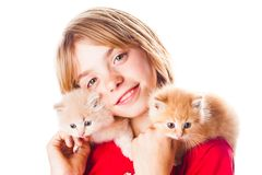 Girl and kittens Stock Image