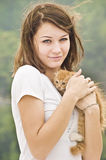 Girl with kitty Stock Images