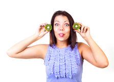 Girl with kiwi Stock Images