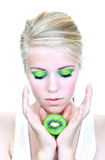 Girl with kiwi Stock Photography
