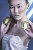 Girl with Kiwi. Beauty woman with sliced kiwi Royalty Free Stock Photography