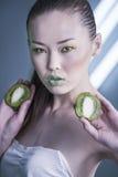 Girl with Kiwi. Beauty woman with sliced kiwi Stock Photography