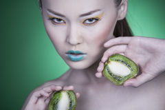 Girl with Kiwi Royalty Free Stock Image