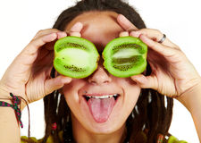 Girl and kiwi on eyes Stock Photos